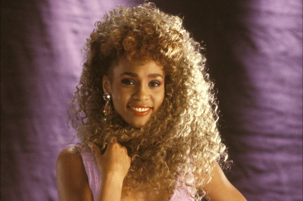 Whitney's big hair and social media success. Image courtesy of Huffington Post